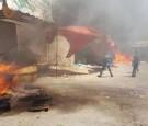 بالصور: تجدد الاشتباكات بالوحدات .. وحريق كبير بسوق '' البالات ''