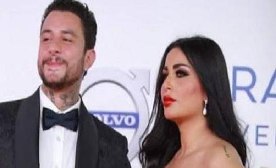 مرة أخرى..الفيشاوي وقُبلاته لزوجته في حفل السينما العربية حديث الجمهور!
