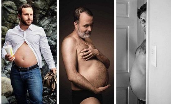 """صور مضحكة: مثل الحوامل.. رجال يحتفلون بـ """"الكرش"""" الجميل"""