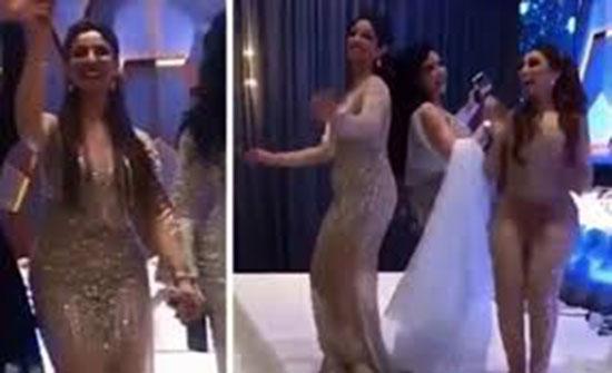بالفيديو - نجمة خليجية تثير الجدل برقصها في زفاف شقيقتها... وفتحات ملابسها