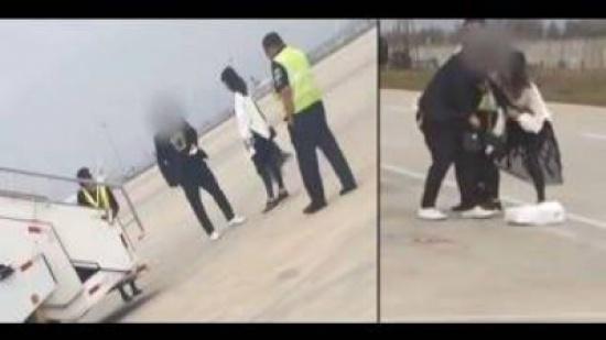 بالفيديو - زوجان يتبادلان اللكمات على أرض المطار