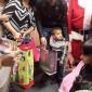 بالصور.. ستار سعد يوزع هدايا لنازحيين عراقيين بأمريكا