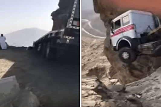 فيديو: شاحنة تعلق في الهواء فوق صخرة على سفح جبل بالطائف.. وهذا مصير السائق