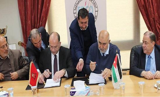اتفاقية مشروع ربط طاقة متجددة بين توزيع الكهرباء وجامعة مؤتة