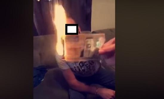 بالصور : القبض على عربي أحرق نقودا أردنية لاشعال سيجارة