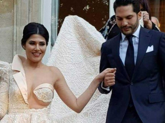 شاهد.. فنانة تونسية تثير الجدل بفستان زفافها الجريء