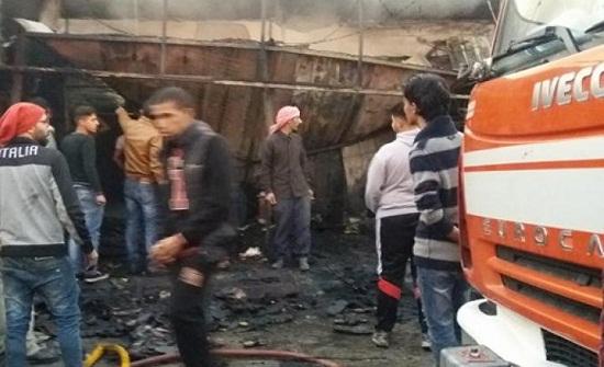شاهدوا بالصور كيف احترقت 3 محال تجارية بإربد