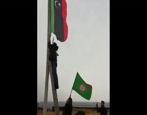"""بالفيديو.. أنصار """"أمل"""" ينزعون علم ليبيا من موقع انعقاد القمة العربية في بيروت"""