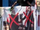 أحد الملصقات لرئيس البرلمان العراقي محمد الحلبوسي والرئيس الإيراني حسن روحاني