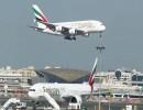 طائرتان تابعتان لشركة طيران الإمارات في مطار دبي. أرشيف