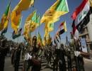 عناصر من كتائب حزب الله العراقي خلال عرض عسكري في بغداد في مايو الماضي (أرشيفية)