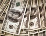 """""""تلميحات الفائدة"""" تقود الدولار إلى الصعود"""