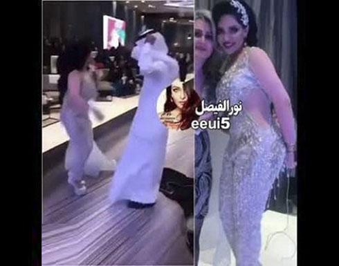 شاهد : فنانة كويتية تثير الجدل بفستان شفاف يظهر جميع جسمها في حفل زفاف شقيقتها