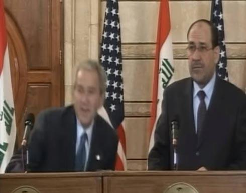خروج الصحافي العراقي راشق بوش بالحذاء من السجن- (فيديو)