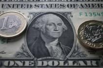 """العجز والتضخم """"يهددان"""" الدولار"""