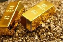 الذهب يهبط والدولار يستقر في أعلى مستوياته