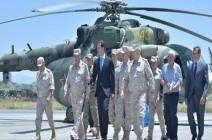 الأسد يزور قاعدة حميميم الجوية الروسية باللاذقية