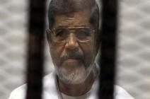 تأجيل إعادة محاكمة مرسي والقرضاوي بقضية اقتحام السجون