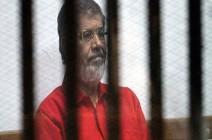 نجل لمرسي: هل سأزور والدي بمحبسه مرة كل 5 سنوات؟