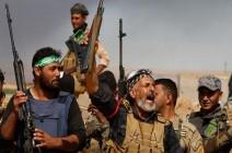 """""""الحشد الشعبي"""": لولا قتالنا في سوريا لسقط النظام"""