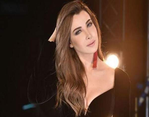 فيديو : نانسى عجرم تستقبل العام الجديد 2020 بفستان مفتوح بابو ظبي