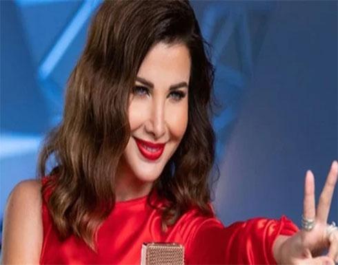 نانسى عجرم بإطلالة بيضاء مكشوفة الصدر تبرز انوثتها .. شاهد
