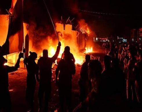 شاهد : اشتباكات مع الأمن وإحراق مكتب البرلمان