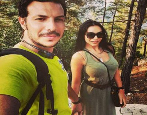 بالصور - زوجة باسل خياط تخطف الأضواء بفستانها الضيق القصير الذي أظهر حملها
