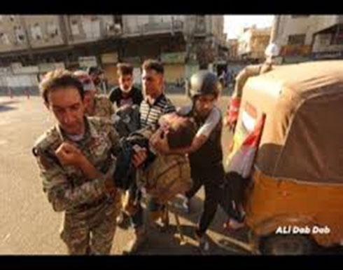 شاهد : قوات الامن العراقي تطلق النار على المتظاهرين في بغداد