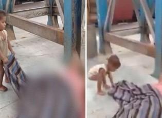 شاهد.. طفل يحاول إيقاظ والدته التي توفت إثر كورونا في محطة القطار