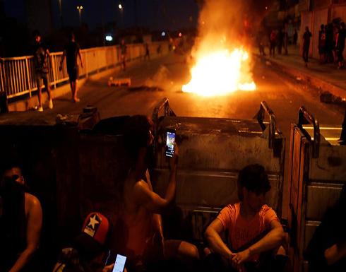 اشتباكات بين متظاهرين وقوات الأمن العراقية في بغداد .. بالفيديو