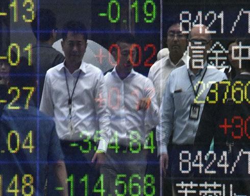"""تباين أداء الأسهم العالمية مع قرب توقيع """"اتفاق التجارة"""""""