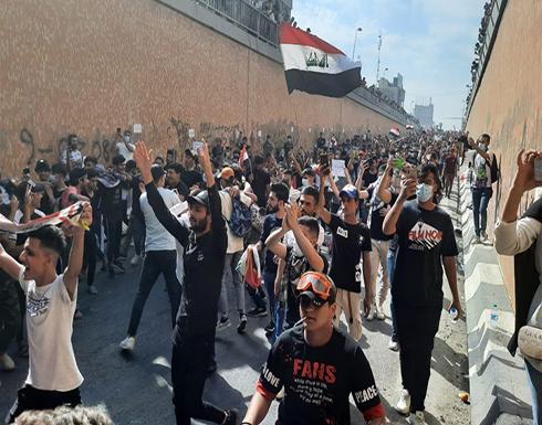 شاهد : آلاف المتظاهرين بالعراق يتدفقون للشوراع بذكرى الحراك