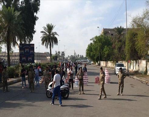 بالفيديو : إصابة 7 متظاهرين قرب ساحة التحرير وسط بغداد