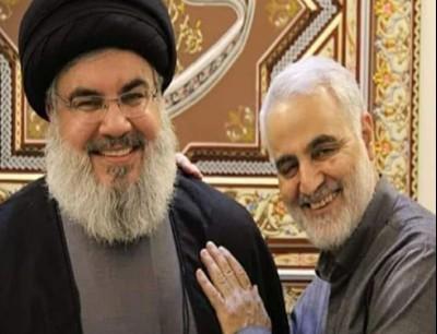 رفع حضور لحظة إزالة الستار عن النصب التذكاري رايات حزب الله