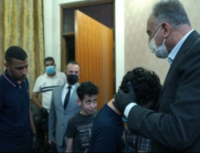 الكاظمي يزور أسرة الهاشمي