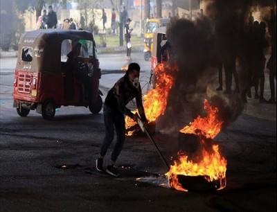 إضرام النار بمقر فصيل مقرب من إيران