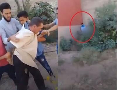 بالفيديو لحظة ضبط رجل يغتصب طفلا في الخلاء