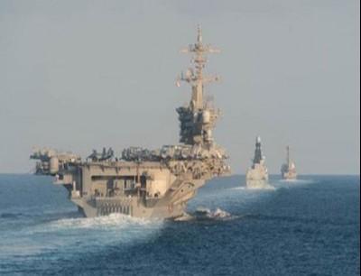 حاملة الطائرات الأميركية تعبر هرمز مع 3 سفن قتالية
