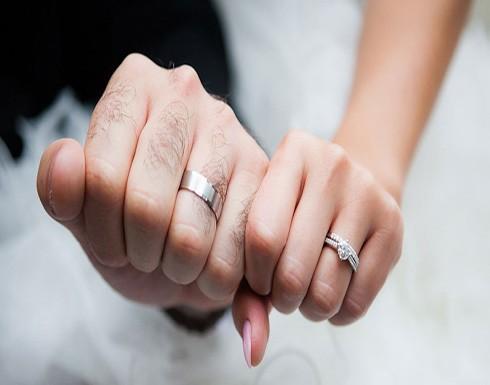بالصور : شاهد.. عروسان يحتفلان بزفافهما في الهواء