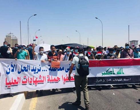 متظاهرون من حملة الشهادات العليا يغلقون شوارع بغداد للمطالبة بالتعيين .. صور