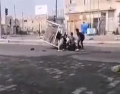 بالفيديو :  لحظة مقتل أب عراقي أمام أبنائه برصاص قوى الأمن يجتاح مواقع التواصل