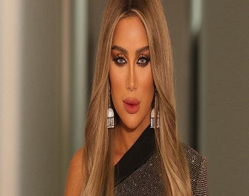 شاهد : مايا دياب ترتدي فستان بفتحة ساق بإطلالة جريئة