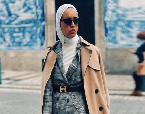 بالصور : أزياء محجبات ..موضة المعاطف الطويلة للشتاء