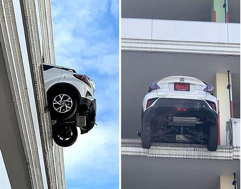 بالفيديو : إمرأة تايلندية تعلق سيارتها على الطابق الرابع