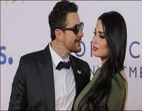 أحمد الفيشاوي يتجاهل قرار حبسه وينشر صورة رومانسية مع زوجته