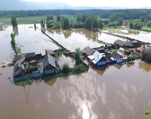 شاهد.. فيضانات تجتاح بلدات في مقاطعة إركوتسك في سيبيريا الروسية