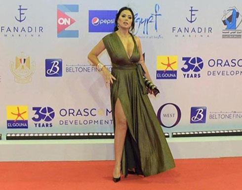 بالفيديو : رانيا يوسف تصدم الجميع بفستان فاضح في مهرجان الجونة