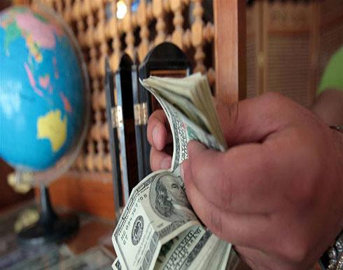 الدولار يتراجع في السوق السوداء ولكن...