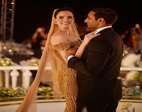 بالصور : عارضة أزياء تونسية ترتدي فستانا من الذهب في يوم زفافها